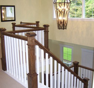Charlevoix Cottage staircase detail from second floor.