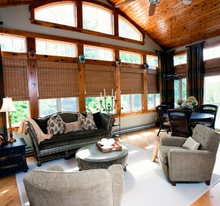 Deer Lake Renovation Veranda Room with window and custom wood treatments.