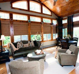 Deer Lake Renovation Veranda Room with window and custom wood treatments.